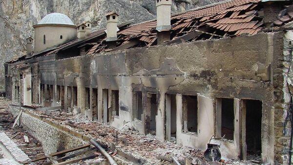 A general view shows the burned facade of the Serbian Orthodox monastery Sveti Arhandjeli in the southwestern Kosovar village of Prizren 23 March 2004 - Sputnik International