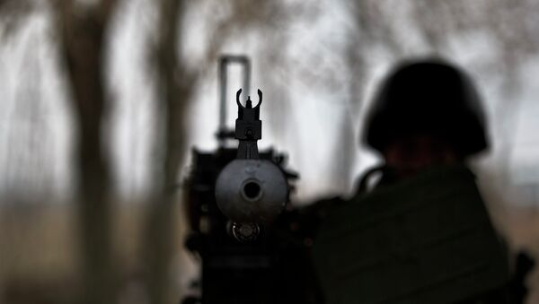 A soldier mans a heavy machine-gun position at a Ukrainian army checkpoint near Kurakhove, Ukraine, Tuesday, March 3, 2015 on a road leading to Russia-backed separatist held territory - Sputnik International