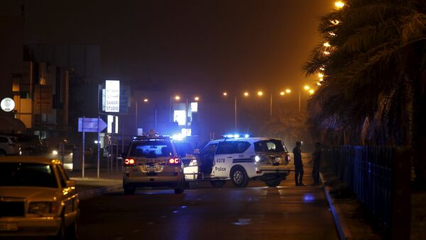 Police cars block the Budaiya highway leading to the blast site where one police officer was killed late Friday evening in Budaiya west of Manama, Bahrain, August 28, 2015. A terrorist blast in a Shi'ite village in Bahrain killed a policeman on Friday, the country's interior ministry said. One policeman killed in the terrorist blast in Karana village, it said on its Twitter account, giving no further details - Sputnik International