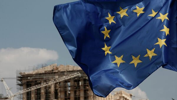 A European Union (EU) flag flutters in front of the temple of the Parthenon in Athens, Greece, Saturday, Aug. 15, 2015 - Sputnik International