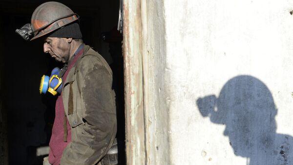 A miner of the Kholodnaya Balka coal mine stands after finishing work, in the eastern Ukrainian city of Makievka, in the Donetsk region, in the self-declared Donetsk People's Republic - Sputnik International