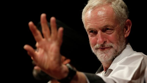 British lawmaker Jeremy Corbyn waves to a member of the audience prior to addressing a meeting during his election campaign for the leadership of the British Labour Party in Ealing, west London, Monday, Aug. 17, 2015. - Sputnik International