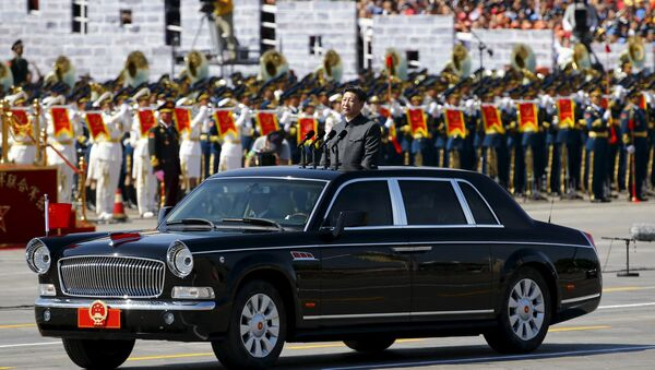 Chinese President Xi Jinping stands in a car on his way to review the army as military band members play next to him, at the beginning of the military parade marking the 70th anniversary of the end of World War Two, in Beijing, China, September 3, 2015 - Sputnik International