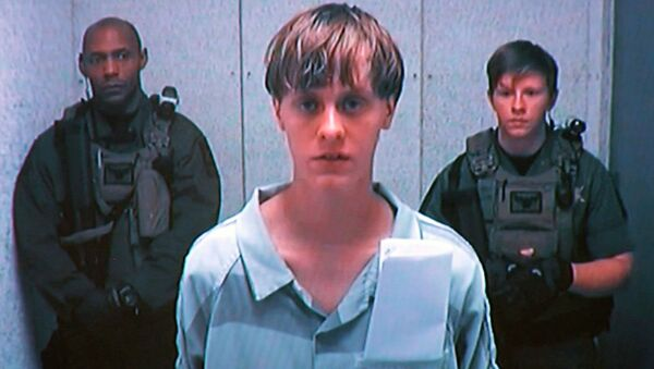 Dylann Storm Roof appears by closed-circuit television at his bond hearing in Charleston, South Carolina in this file photo taken from video June 19, 2015 - Sputnik International