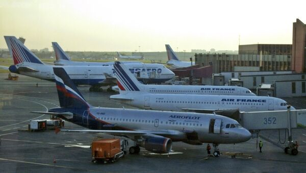 Passenger planes belonging to Aeroflot, Air France and Transaero parked on the tarmac at Moscow's Sheremetyevo airport, Moscow. - Sputnik International
