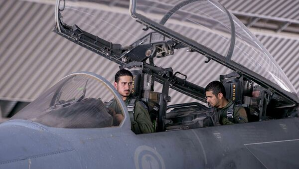 FILE - In this file photo released Sept. 24, 2014 by the official Saudi Press Agency, Saudi pilots sits in the cockpit of a fighter jet as part of US-led coalition airstrikes on Islamic State militants and other targets in Syria, in Saudi Arabia - Sputnik International