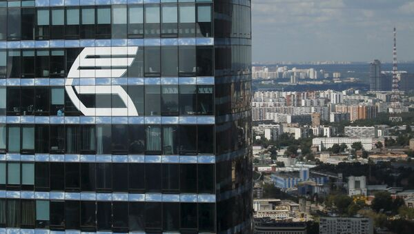 The logo of VTB Group is seen through a window of Imperia Tower on the facade of the Federatsiya (Federation) Tower at the Moscow International Business Center also known as Moskva-City, in Moscow, Russia, in this August 5, 2015 file photo - Sputnik International