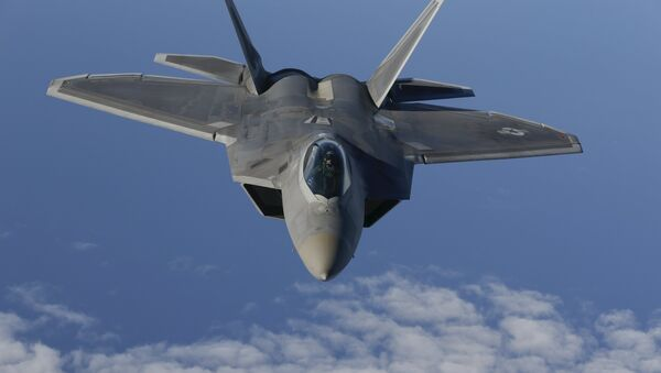 A F-22 Raptor fighter jet of the 95th Fighter Squadron from Tyndall, Florida approaches a KC-135 Stratotanker from the 100th Air Refueling Wing at the Royal Air Force Base in Mildenhall in Britain as they fly over the Baltic Sea towards the newly established NATO airbase of Aemari, Estonia September 4, 2015. - Sputnik International