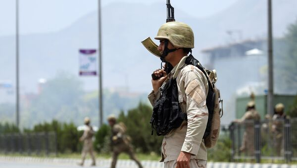 Afghan security forces gather at the site of an attack by Taliban fighters outside the parliament in Kabul, Afghanistan, Monday, June 22, 2015 - Sputnik International