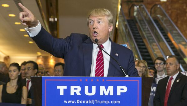 U.S. presidential hopeful Donald Trump speaks during a press availability after signing a pledge with the Republican National Committee (RNC) at Trump Tower in Manhattan, New York September 3, 2015 - Sputnik International