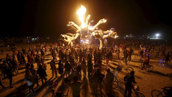 Participants gather at Medusa Madness during the Burning Man 2015 Carnival of Mirrors arts and music festival in the Black Rock Desert of Nevada, September 6, 2015 - Sputnik International