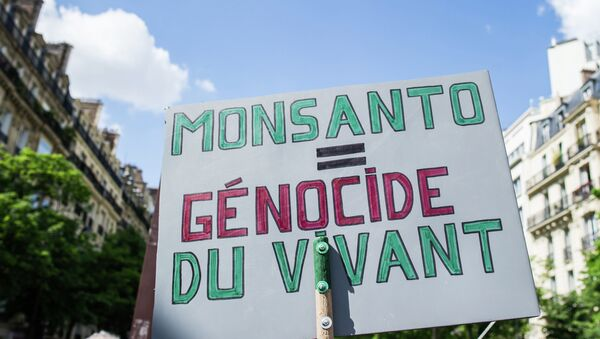 A banner is photographed, during a World March Against Monsanto, in Paris, France, in Paris, Saturday, May 23 2015 - Sputnik International