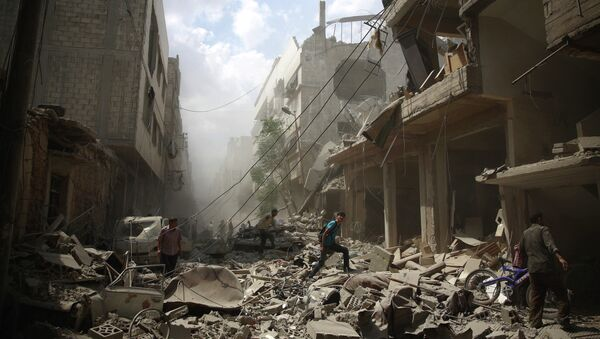 Syrians walk amid the rubble of destroyed buildings following reported air strikes by regime forces in the rebel-held area of Douma, east of the capital Damascus, on August 30, 2015 - Sputnik International