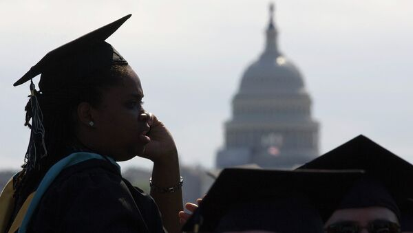 With the US Capitol as a backdrop, George Washington University students gather for their commencement ceremony on the National Mall in Washington - Sputnik International
