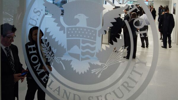 The Department of Homeland Security logo is seen at the new ICE Cyber Crimes Center expanded facilities in Fairfax, Virginia July 22, 2015. - Sputnik International