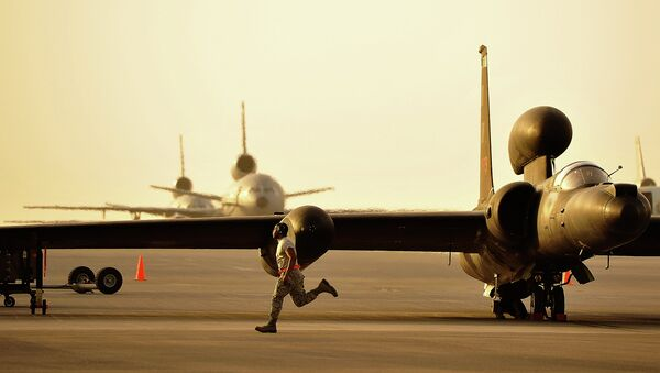 A member of the 380th Expeditionary Aircraft Maintenance Squadron assists in the removal of the temporary landing gear on a U-2. - Sputnik International