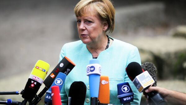 German Chancellor Angela Merkel, speaks to media after a visit of a so called 'Welcome Class', a special school class for migrants and refugees at the Ferdinand-Freiligrath school in Berlin, Germany, Thursday, Sept. 10, 2015. - Sputnik International