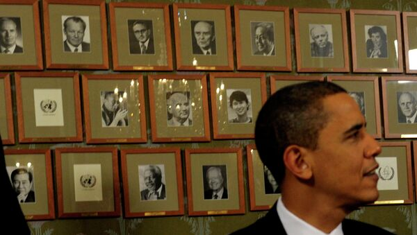 President Barack Obama sits in front of framed photos of previous Nobel Peace Prize winners during a Signing Ceremony at the Norwegian Nobel Institute in Oslo, Norway, Thursday, Dec. 10, 2009. - Sputnik International