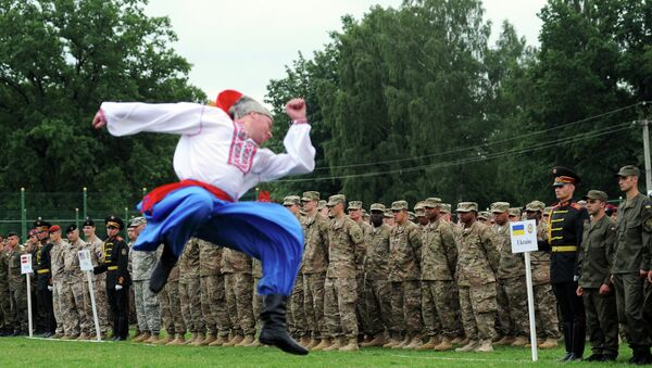 Ukrainian folk dancers perform for Ukrainian and US servicemen in a ceremony for joint-drill exercises between the two countries in Yavoriv polygon, Lviv district, western Ukraine - Sputnik International