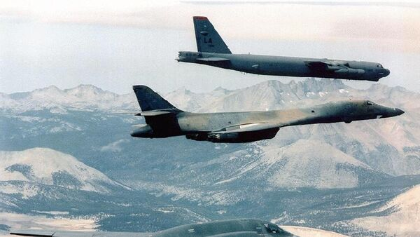 B-2 Spirit (bottom) bomber flying with B-1B (C) and B-52 bombers at an undisclosed location over Afghanistan, file photo. - Sputnik International