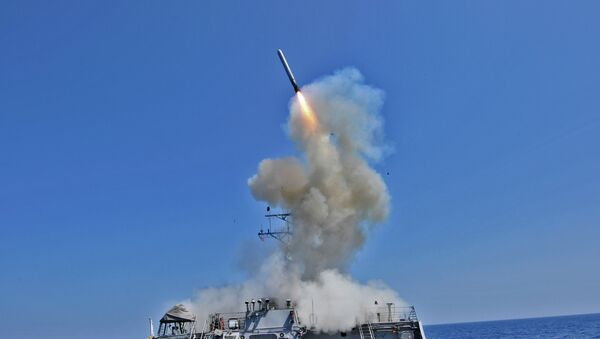 The guided missile destroyer USS Barry (DDG 52) launches a Tomahawk cruise missile - Sputnik International