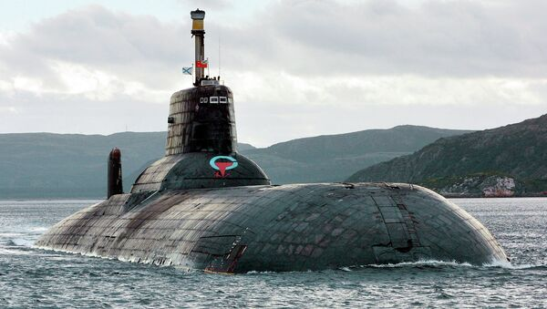 One of Russia's largest Soviet-built nuclear submarines, Typhoon (Akula) class, which remains the world's largest with the displacement of about 25,000 metric tons (27,500 tons) heaves ahead in the Barents Sea at Russia's Arctic Coast in this September 2001 photo - Sputnik International