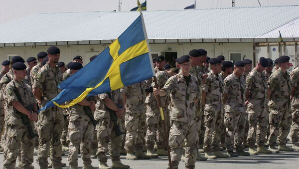 Swedish soldiers part of the International Security Assistant Force (ISAF) stand during a changing of command ceremony at the Swedish run Provincial Reconstruction Team in Mazar Sharif north of Kabul, Afghanistan on Tuesday May 6, 2008 - Sputnik International
