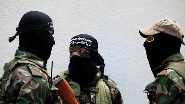 Palestinian militants attend the funeral of Mohammed al-Awor, 33, in Beit Lahia, northern Gaza Strip, on Thursday, June 12, 2014. - Sputnik International