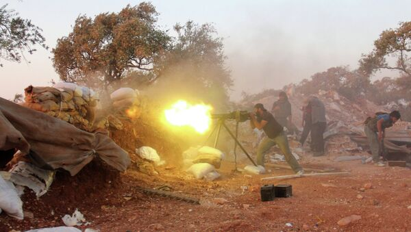A rebel fighter fires heavy artillery during clashes with government forces and pro-regime shabiha militiamen in the outskirts of Syria's northwestern Idlib province on September 18, 2015 - Sputnik International