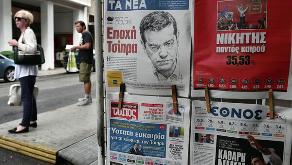 Frontpages of newspapers bear pictures of Syriza leader Alexis Tsipras a day after the Greek general election in Athens on September 21, 2015 - Sputnik International