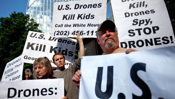 File photo of demonstrators protest against the use of drones outside the International Conference on Unmanned Aircraft Systems at the Grand Hyatt Hotel, Tuesday, May 28, 2013, in Atlanta - Sputnik International