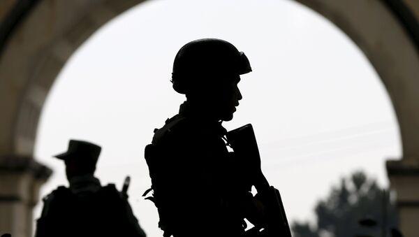 Afghan security forces stand guard. - Sputnik International