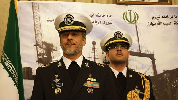 Rear Admiral Habibollah Sayyari (L), commander of the Iranian navy, stands under portraits of Iranian supreme leader Ayatollah Ali Khamenei and late revolutionary founder Ayatollah Khomeini (L) during a press conference at the Iranian embassy in the Syrian capital Damascus on February 28, 2011 - Sputnik International