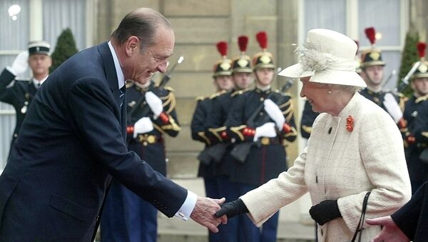 Queen Elizabeth II and French President Jacques Chirac shake hands as Republican Guards salute the queen's arrival at the Elysee Palace in Paris Monday, April 5, 2004, as she started a three-day state visit to France to mark 100 years of formal friendship between France and Britain.  - Sputnik International