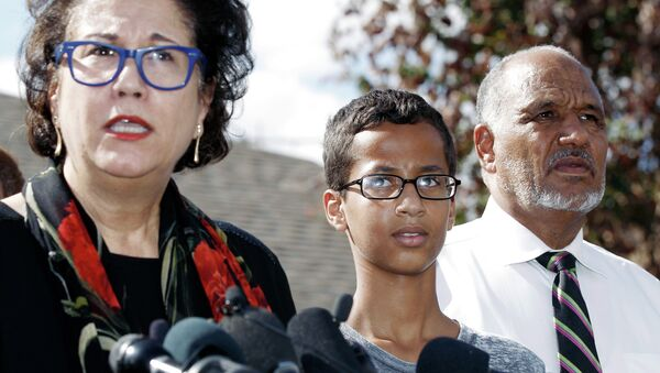 Ahmed Mohamed, 14, center, and his father Mohamed Elhassan Mohamed, right, look on as their attorney Linda Moreno, left, delivers a statement about the arrest of Ahmed during a news conference, Wednesday, September 16, 2015, in Irving, Texas - Sputnik International
