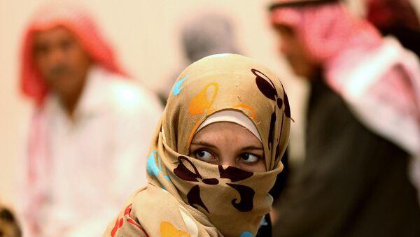 A Syrian refugee waits at a clinic at the Zaatari refugee camp as German Economy Minister Sigmar Gabriel visits the camp near Mafraq, north of Amman, Jordan, Tuesday, Sept. 22, 2015. - Sputnik International