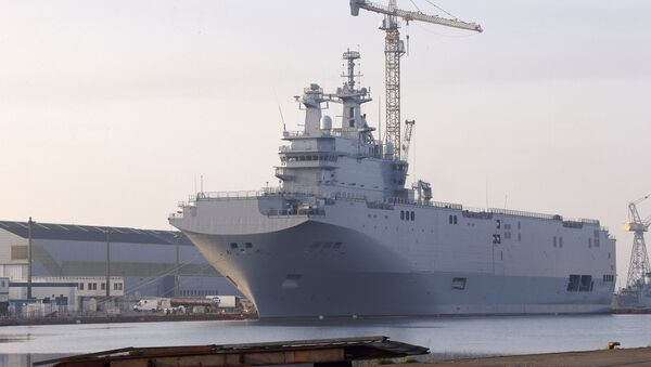 In this Friday, Sept. 5, 2014 file photo, the Vladivostok warship, the first of two Mistral-class helicopter carriers ordered by Russia, docks on the port of Saint-Nazaire, western France. - Sputnik International