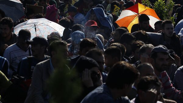 Syrian refugees wait to be escorted to a train after they crossed the Hungarian border from Croatia. - Sputnik International