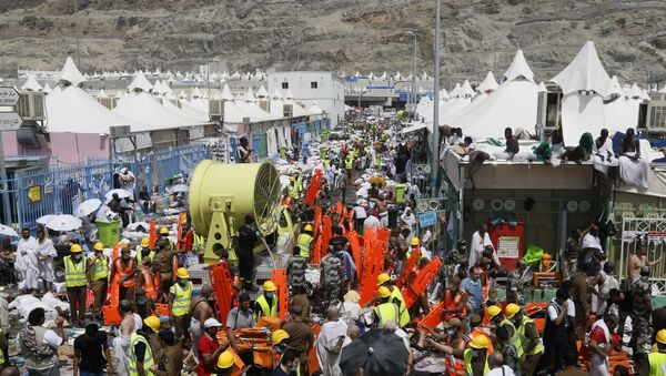 Muslim pilgrims and rescuers gather around the victims of a stampede in Mina, Saudi Arabia during the annual hajj pilgrimage on Thursday, Sept. 24, 2015 - Sputnik International
