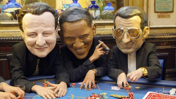Oxfam international activists pose as British Prime Minister, David Cameron, left, United State President Barak Obama, and French President Nicolas Sarkozy, right. - Sputnik International