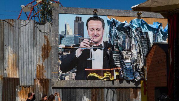 A poster of British PM David Cameron at Dismaland. - Sputnik International