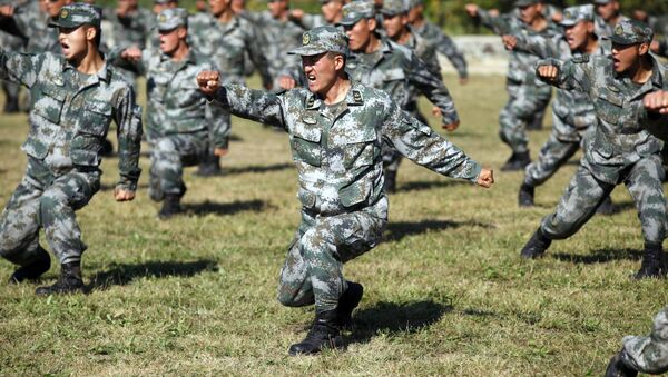 Chinese People's Liberation Army (PLA) soldiers training at their barracks in Heihe, northeast China's Heilongjiang province - Sputnik International