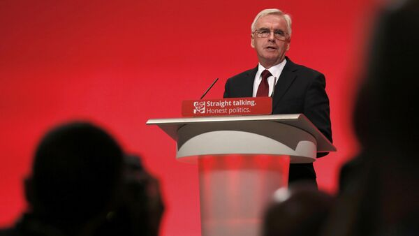 Members of the media photograph Britain's shadow Chancellor of the exchequer John McDonnell as he speaks at the annual Labour Party Conference in Brighton, southern Britain 28 September, 2015 - Sputnik International