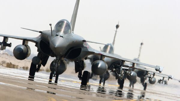This photo released on Sunday, Sept. 27, 2015 by the French Army Communications Audiovisual office (ECPAD) shows French army Rafale fighter jets on the tarmac of an undisclosed air base as part of France's Operation Chammal launched in September 2015 in support of the US-led coalition against Islamic State group - Sputnik International