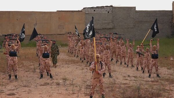 FILE - In this photo released on April 25, 2015, by a militant website, which has been verified and is consistent with other AP reporting, young boys known as the lion cubs hold rifles and Islamic State group flags as they exercise at a training camp in Tal Afar, near Mosul, northern Iraq - Sputnik International