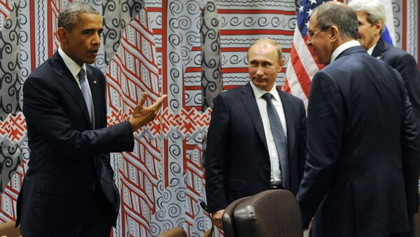 US President Barack Obama, left, gestures while speaking to Russian President Vladimir Putin, third right, as Russian Foreign Minister Sergey Lavrov, second right, and US Secretary of State John Kerry, right, look at him before a bilateral meeting at United Nations headquarters in New York, Monday, Sept. 28, 2015. - Sputnik International