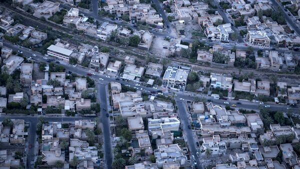 An aerial picture taken on board a helicopter shows a view of the Iraqi capital Baghdad on June 23, 2014 - Sputnik International