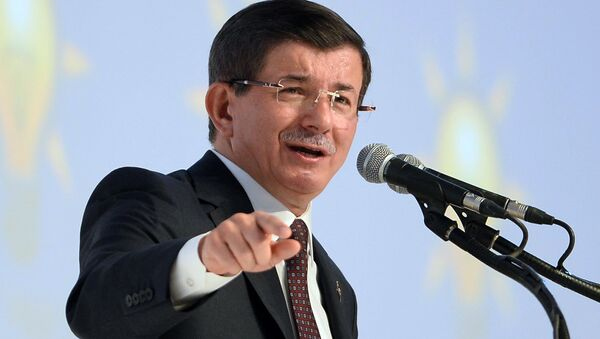 Turkish Prime Minister and Justice and Development Party (AKP) leader Ahmet Davutoglu delivers a speech during the introductory meeting of AKP candidates for the upcoming general election at Ankara Sports Hall on September 21, 2015 - Sputnik International