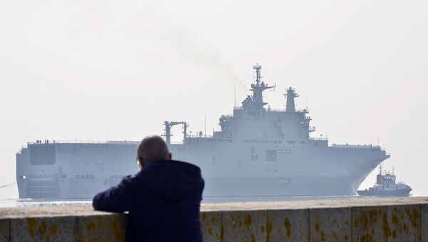 This file photo taken on March 16, 2015 off Saint-Nazaire, northwestern France, shows the Sevastopol mistral warship on its way for its first sea trials. - Sputnik International