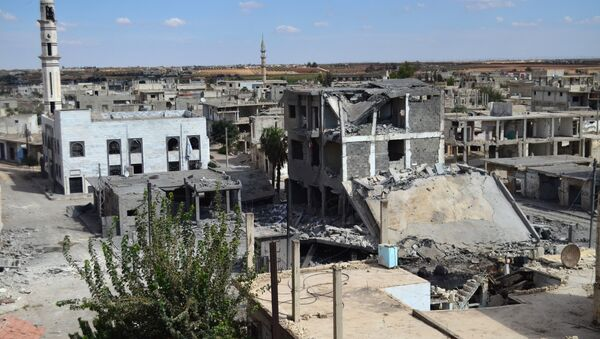 A picture taken on September 30, 2015 shows a general view of deserted streets and damaged buildings in the central Syrian town of Talbisseh in the Homs province - Sputnik International